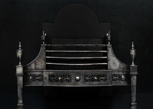 A George III style steel firegrate with pierced fret