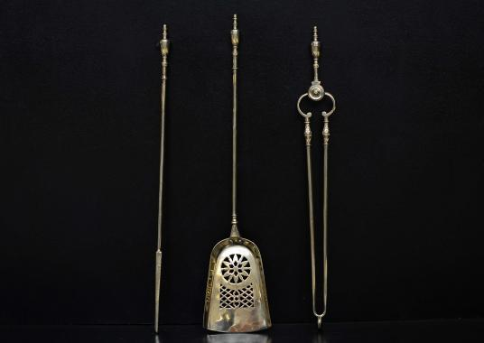A set of brass firetools with pierced shovel