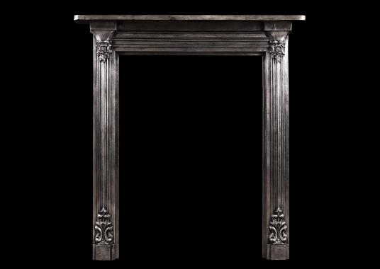 A polished cast iron fireplace