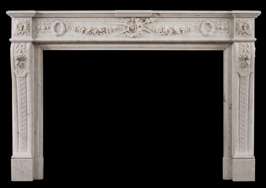 A well carved Louis XVI style French antique fireplace