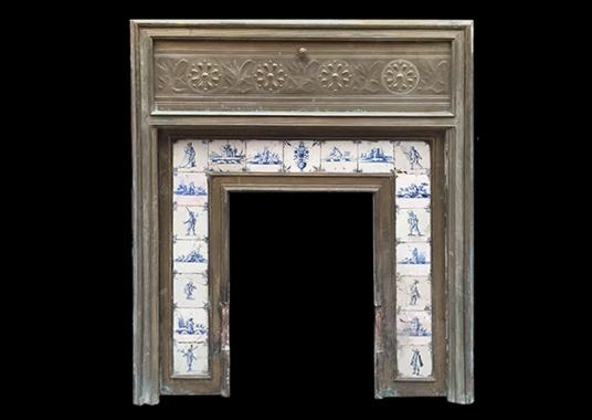 An unusual brass fire surround with delft tiles to insert