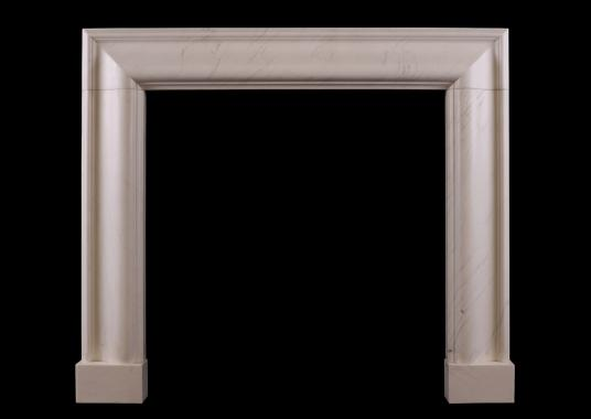 A white marble bolection fireplace