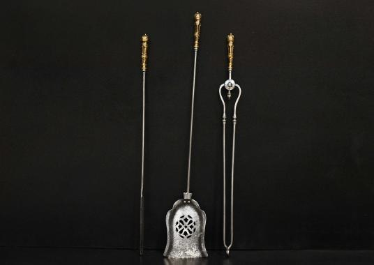 A set of 19th century steel and brass firetools