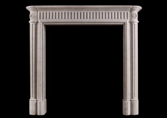 An unusually tall French marble fireplace