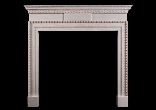 A delicate, late Georgian style white marble fireplace