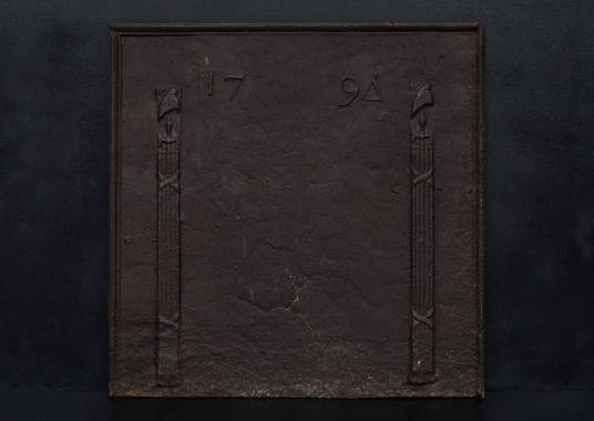 An 18th century cast iron fireback