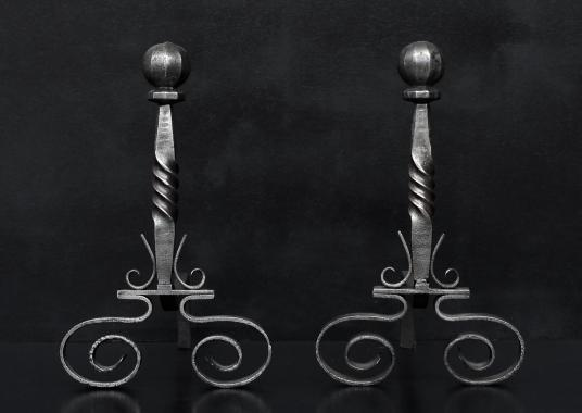 A pair of firedogs with ball finials