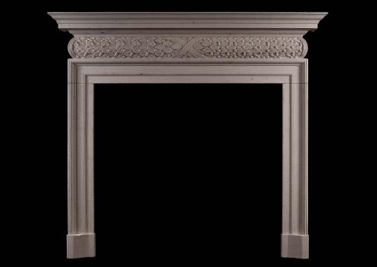 A mid 18th century style antiqued limestone fireplace