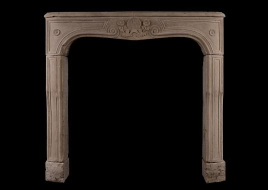 A carved Louis XV limestone fireplace