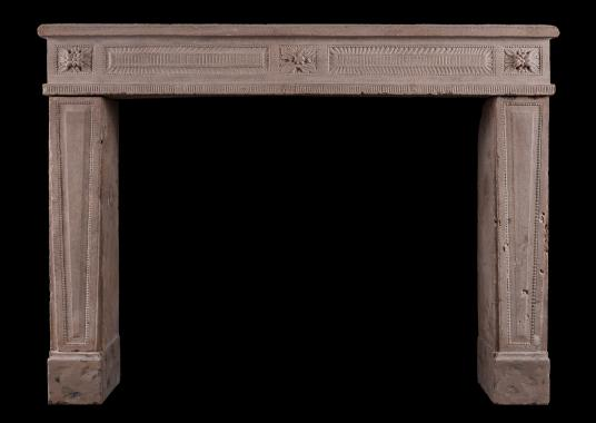 A carved French Louis XVI fireplace