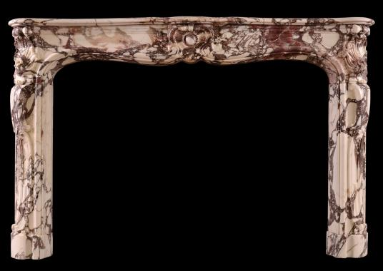 A period Louis XV fireplace in Breche Violette marble