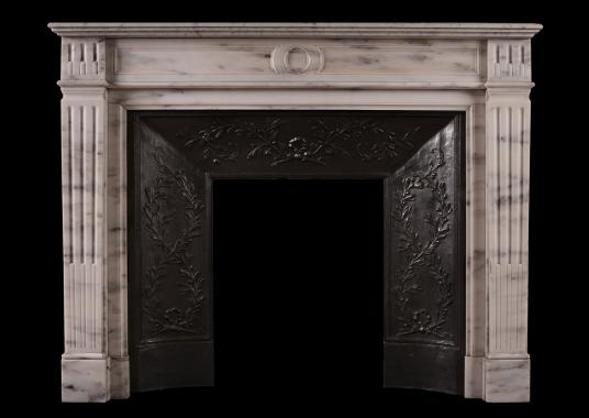A French marble fireplace in the Louis XVI manner