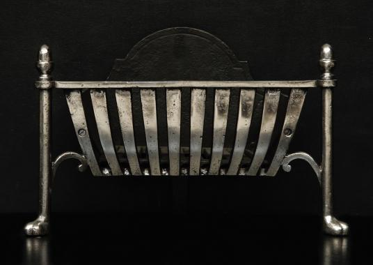 A stylish polished firebasket with an Art Deco influence