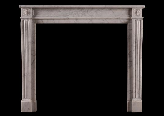 A 19th century carved marble fireplace in the Louis XVI style