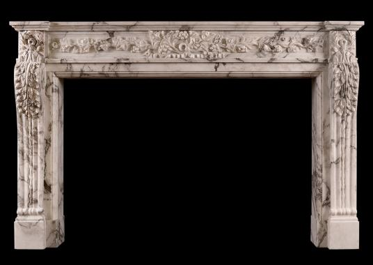 A carved French Arabescato marble fireplace
