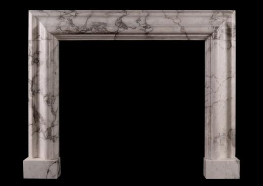 A moulded bolection fireplace in Arabascato marble