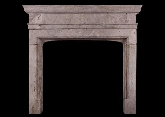 A rustic English fireplace in the Gothic manner