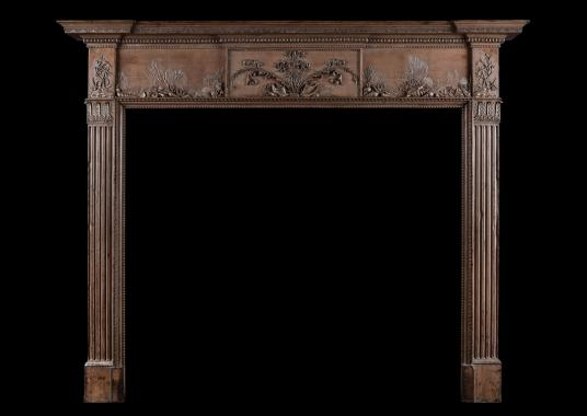 An antique wood fireplace with marine adornments