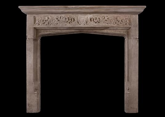 An English 19th century Bath stone fireplace in the Gothic style