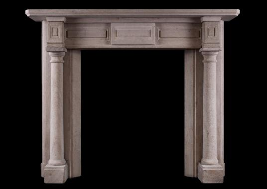 An English sandstone fireplace in the Georgian style