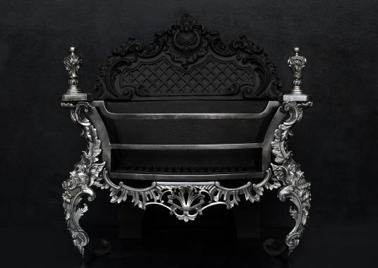 A decorative Rococo firegrate in German silver