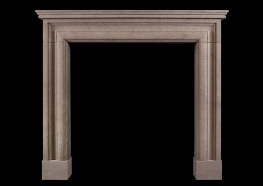 A moulded Bath stone fireplace of small scale