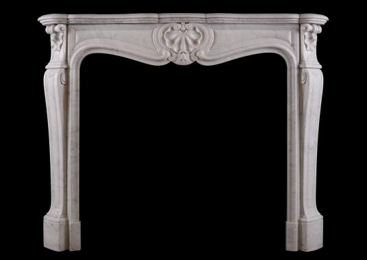 A French Louis XV style fireplace in Italian Carrara marble