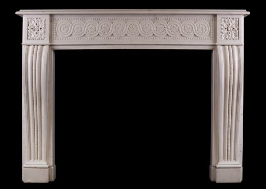 A carved Italian Statuary marble fireplace