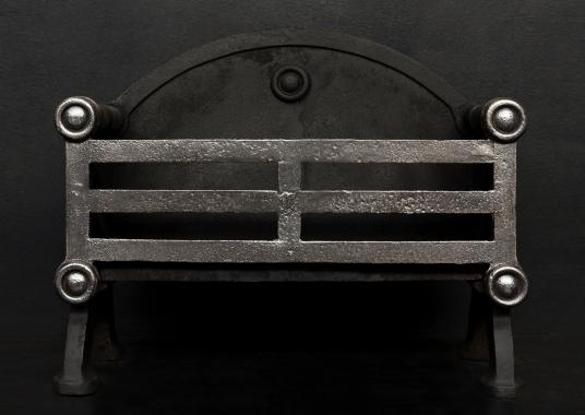 A polished cast iron firegrate