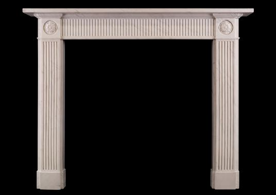 A white marble fireplace in the Regency style