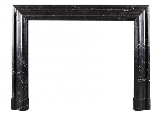 A bolection fireplace in Nero Marquina marble