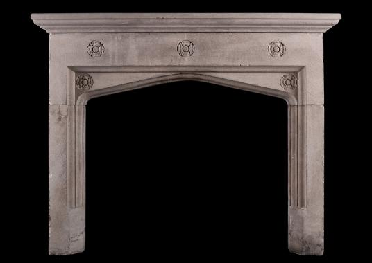 A carved Bath stone fireplace in the Gothic style