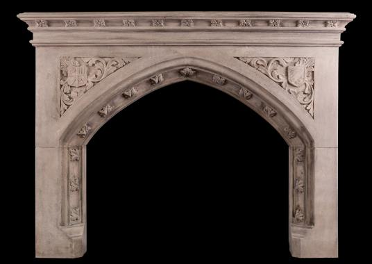 A good quality carved Gothic style fireplace