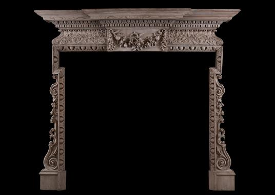 A good quality English carved fireplace
