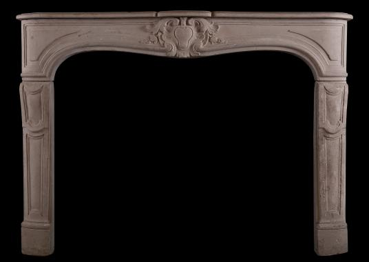 A carved Louis XV style limestone fireplace