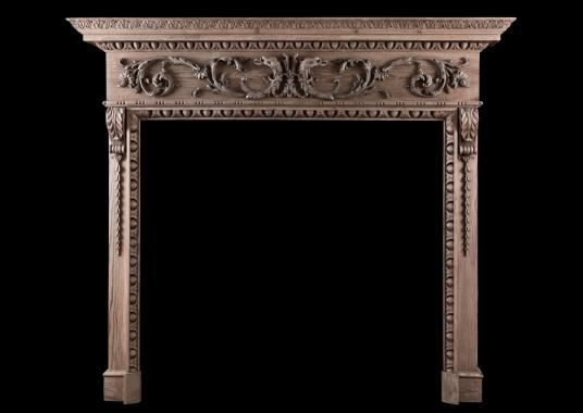 A fine quality carved pine fireplace