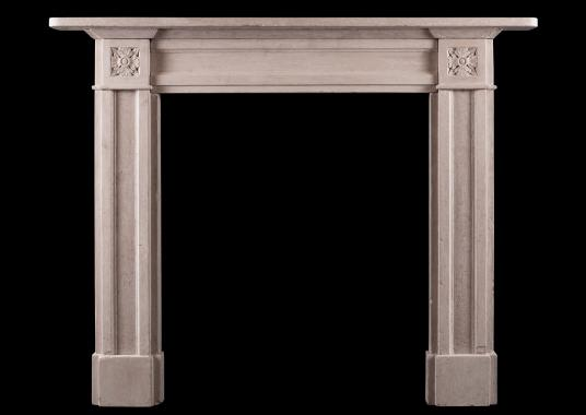 A small scale stone Regency style fireplace