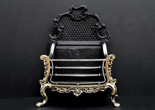 A brass and steel Rococo firegrate