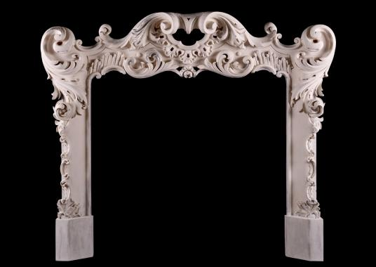 A highly decorative Rococo timber fireplace