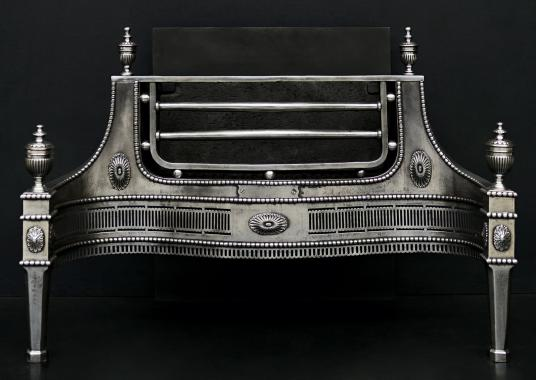 A polished steel fire basket in the Georgian style
