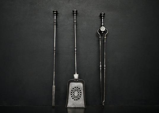 A set of polished steel finials
