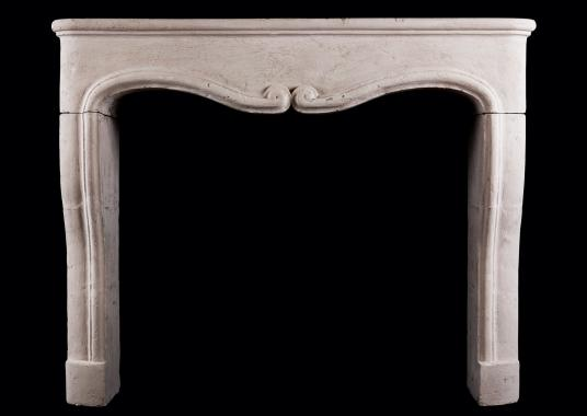 A small scale rustic French fireplace