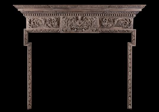 A carved timber fireplace in the Georgian style