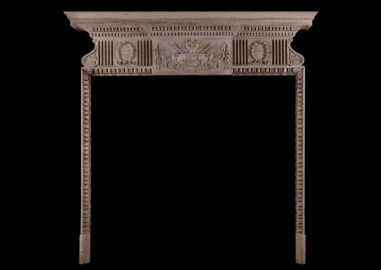 An English pine fireplace in the Georgian manner