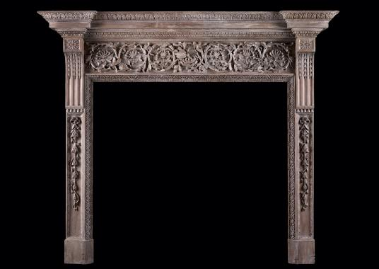 A large and impressive carved wood fireplace
