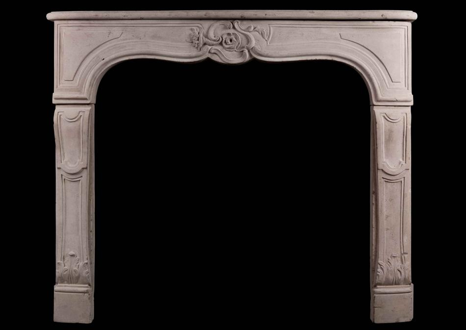 A period 18th Century French Louis XV Limestone Fireplace