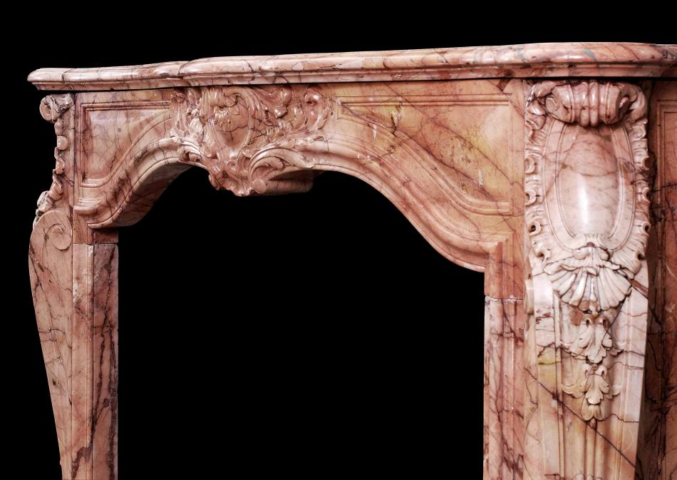 An 18th century French transitional Louis XIV/XV marble fireplace