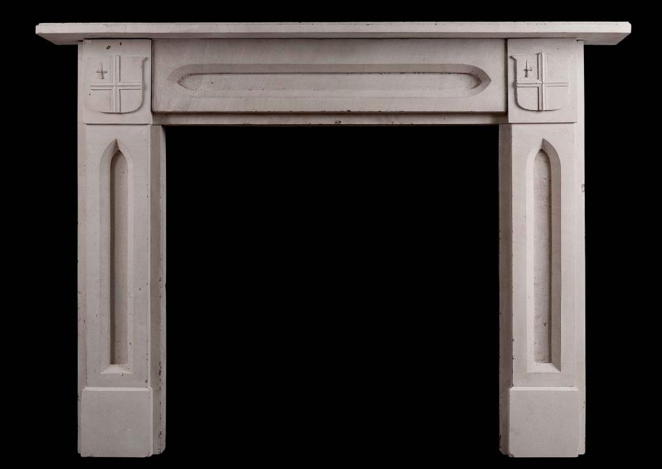 An English stone Gothic style fireplace