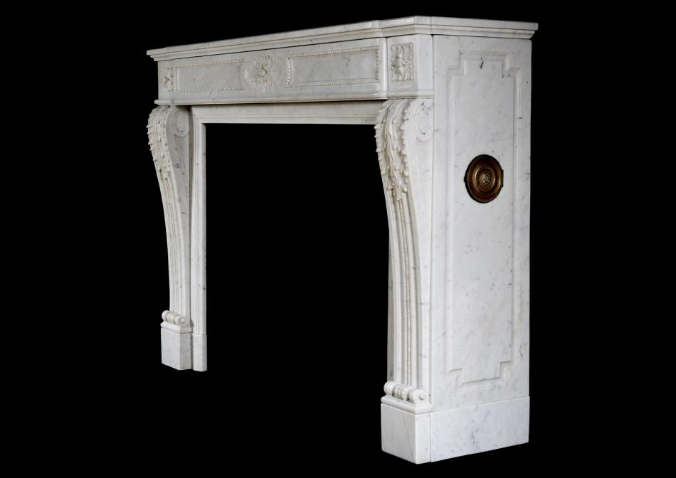 A French Louis XVI style antique fireplace in Carrara marble