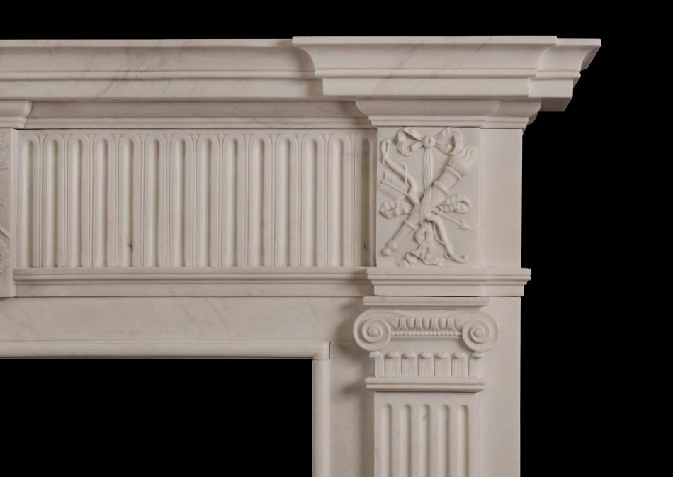 A Georgian Style White Marble Chimneypiece with Rams head to centre plaque